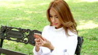 Woman using mobile smart phone video