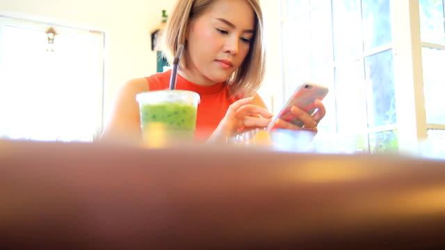 Woman Using Mobile Smartphone in restaurants. video