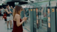woman using phone at station video