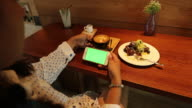 Woman using phone with green screen at coffee shop video