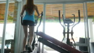 Woman Using  Running Machines In Gym video