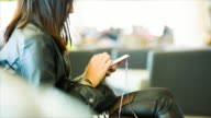 Woman using smart phone at the airport video