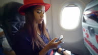 Woman using smart phone on airplane video