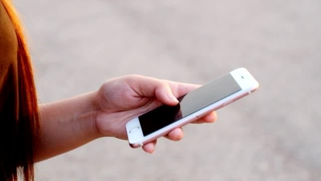 Woman Using Smart Phone video