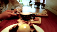 Woman using smartphone at coffee shop, Slow motion video