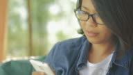 Woman using smartphone take a photo video