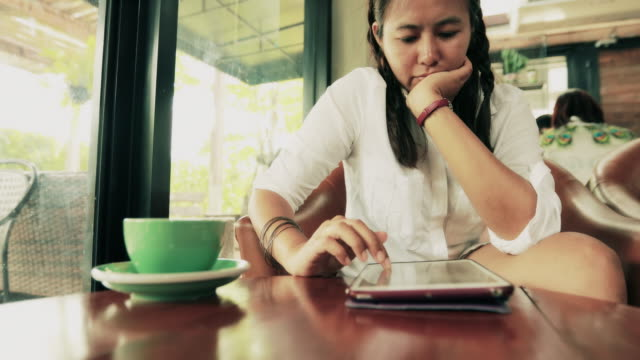 Woman using tablet at cafe , Slow motion video