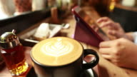 Woman using tablet at cafe video
