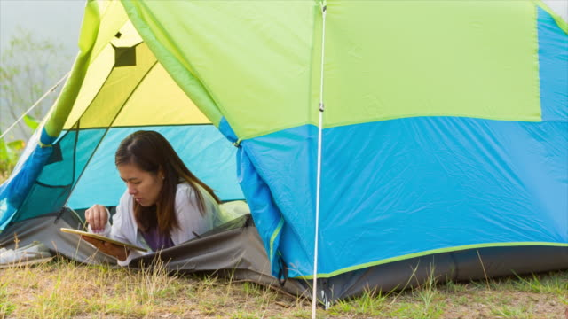 Woman Using Tablet In The Campsite video