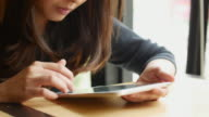 Woman using tablet PC in Cafe, Dolly Shoe video