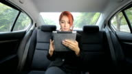 woman using tablet video