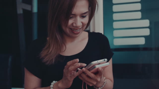 woman using the smart phone video