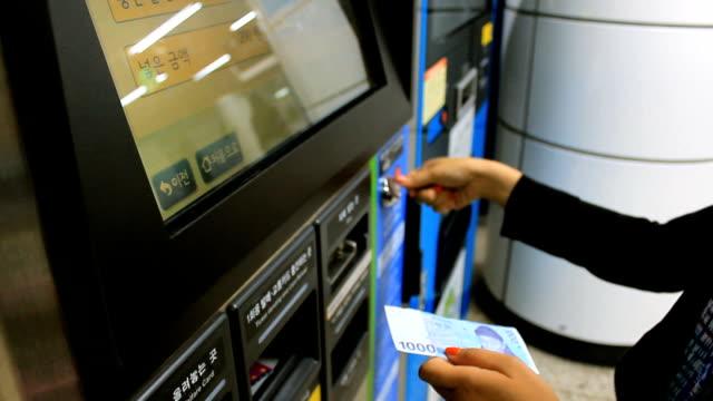 Woman using ticket matchine video