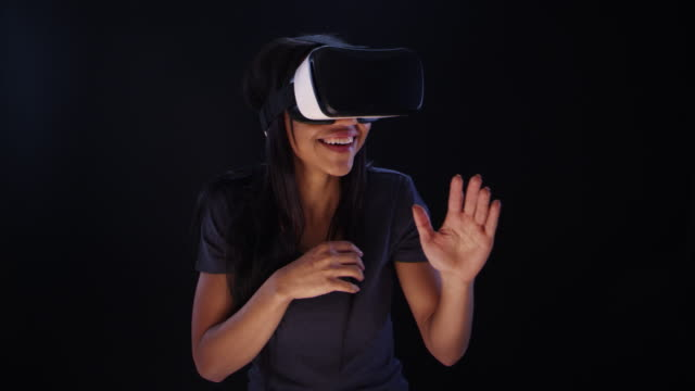 Woman using virtual reality glasses. Admiring virtual world video