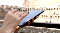 Woman using with Ipad Inside the Colosseum of Rome, Italy video
