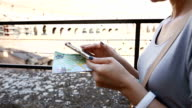 Woman using with Smartphone Inside the Colosseum of Rome, Italy video