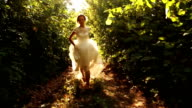 Woman Vintage Dress Running in Forest Smiling Runaway Bride video