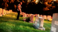 Woman Visits Grave in Cemetery video
