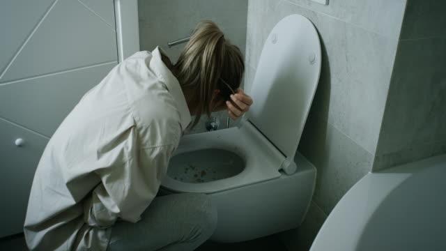 Woman Vomiting In Bathroom video