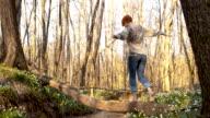 DS Woman walking across a creek video