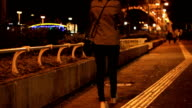 woman walking alone in street night video