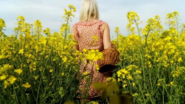 HD STEADY SHOT: Woman Walking Along Fields video