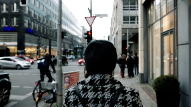 Woman walking down the city - rear view. video