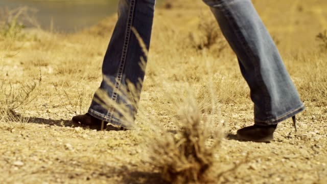 Woman Walking in Desert. Western style. Shot on RED EPIC DRAGON Digital Cinema Camera with Ultra Prime Lenses. video
