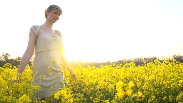 HD SLOW-MOTION: Woman Walking In The Canola Field video