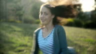 Woman walking in the park video
