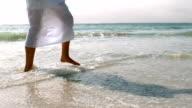 Woman walking in the water video