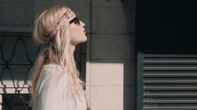 Woman walking in urban setting video
