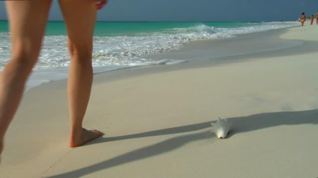 woman walking on a beach video