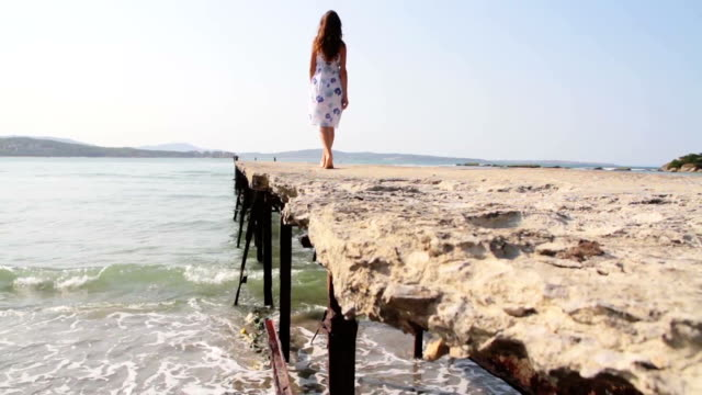 Woman Walking on Old Pier Beauty Vacation Concept HD video