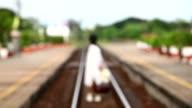 Woman walking on rail , blur video