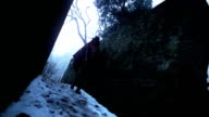 Woman walking on snow from the Andes video