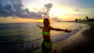 Woman walking on the beach during sunset. Happiness video