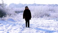 Woman walking on the road video