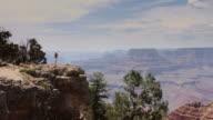 Woman Walking Out On Grand Canyon Outcrop video