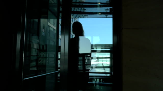 Woman Walking out the Hotel Elevator video