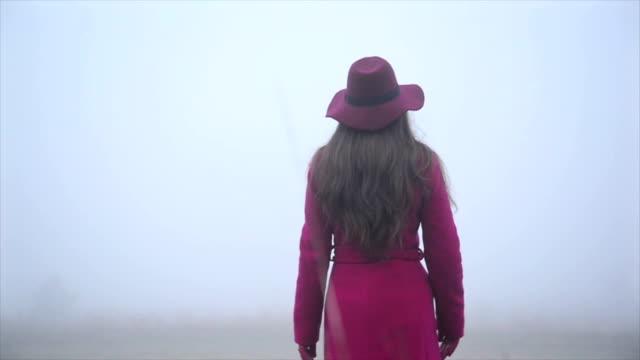 Woman walking through meadow. Slow motion video