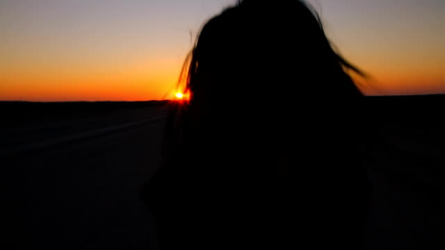 TS Woman Walking Toward The Sun video