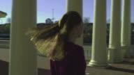 HD STEADICAM: Woman walking towards the edge video