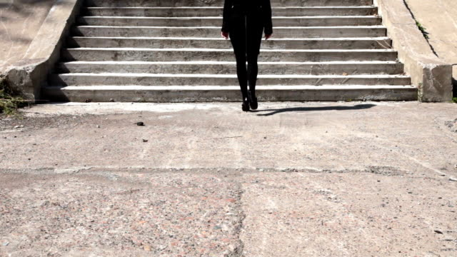 Woman walking up the steps video