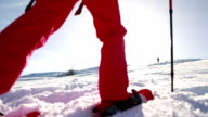 Woman walking uphill with snowshoes video