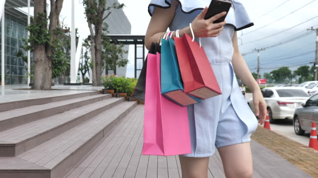Woman walking with shopping bags in Shopping mall video