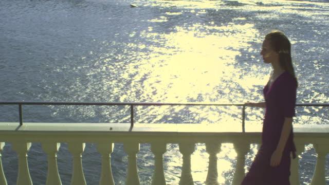 HD STEADICAM: Woman walks along the water video