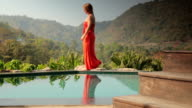 Woman Walks by a Private Swimming Pool on Vacation video
