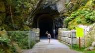 Woman Walks into Train Tunnel, Gravel Path, Othello Tunnels, Hope BC Canada video