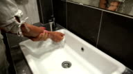 Woman washes hands video